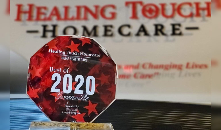 a close up picture of an award for healing touch homecare