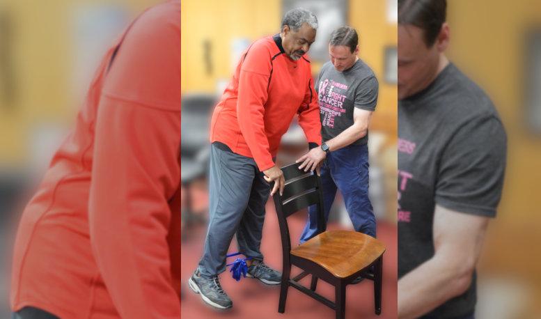 a caregiver helping an elderly